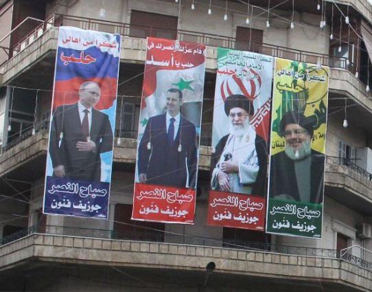 """La """"liberazione"""" di Aleppo: ritratti di Putin, Assad, Khamenei e del capo di Hezbollah Nasrallah esposti ad Aleppo ovest. Hanno dimenticato Erdogan e Obama."""